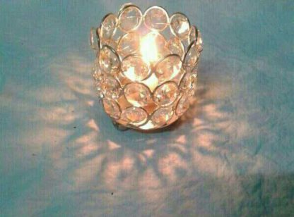 Aluminium and crystal tee light